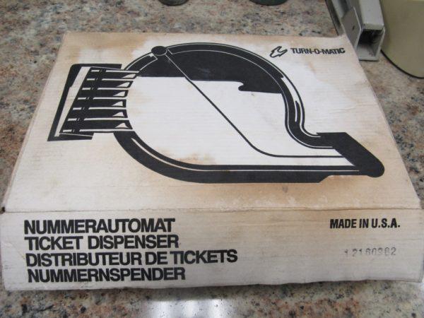 Turn-O-Matic Ticket Dispenser Nummerautomat